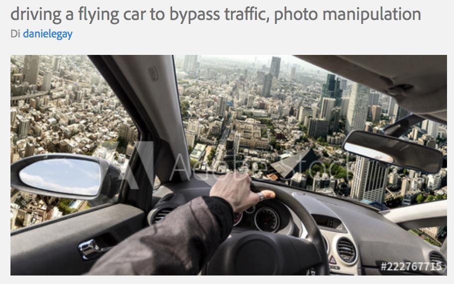 Stock image di un'auto volante sopra una città